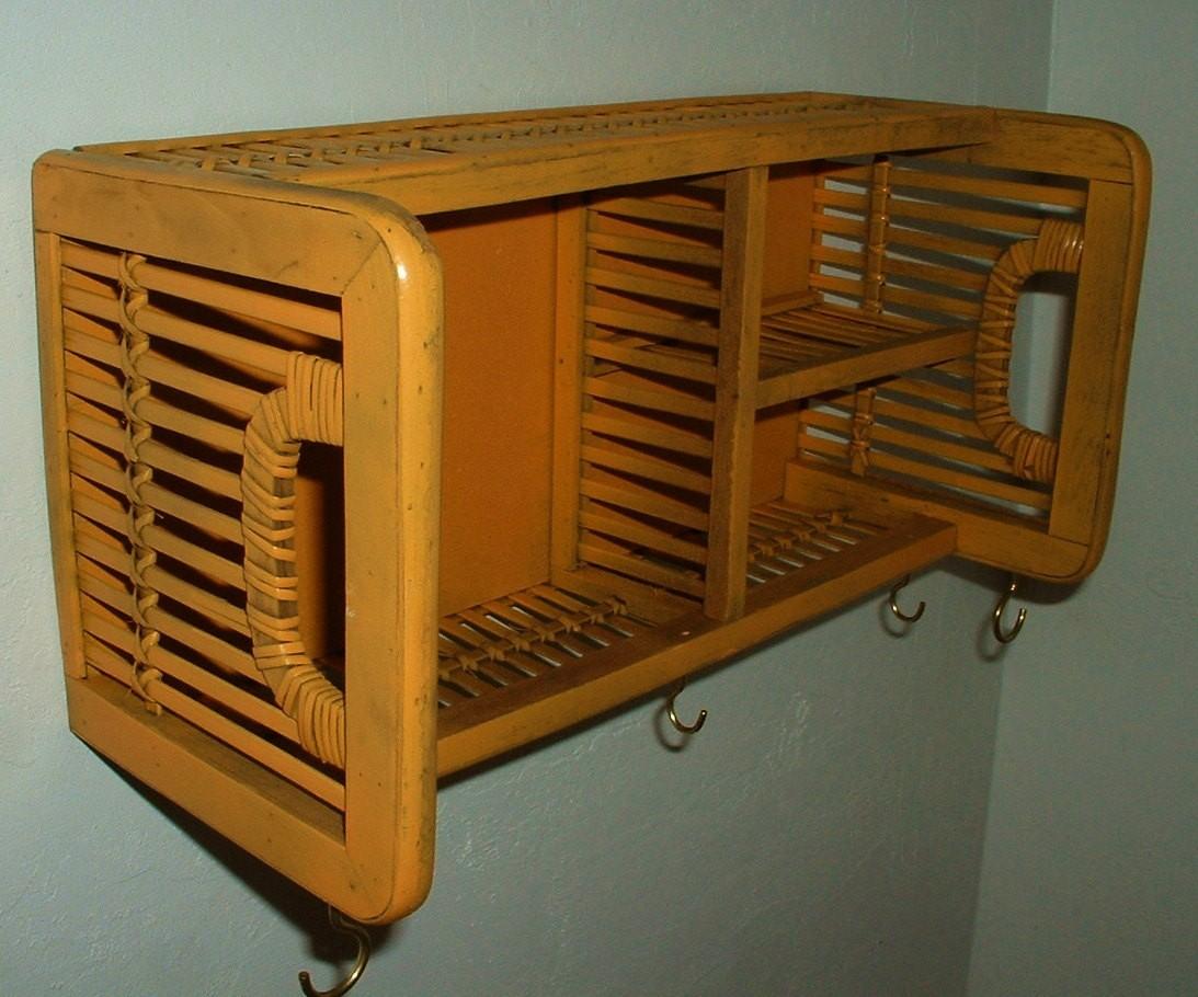 Wall shelf with hooks and baskets